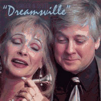 "Ginger and Scott's ""Dreamsville"" cover. Ginger holds up trombone horn mouthpiece, and the picture features the couple examining it curiously."